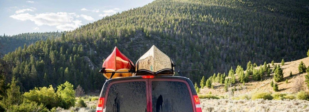 The Frost River van, loaded up with a beautiful wood-canvas solo canoe, and one of the Save the BWCA Signature Canoes on our way through the rockies on the 2015 Made in USA Road Trip.