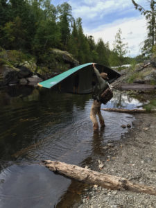 Raising the canoe at the end of Little Saganaga in the BWCA. Photo by Lacey Messenger