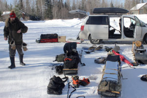 Loading toboggans for a winter camping outing in the BWCAW