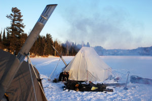"""Hot Tents"" usually made of canvas equipped with portable woodstoves are an important part of a comfortable winter camp."